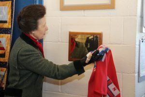 HRH Princess Anne visited Porthcawl RNLI Lifeboat Station on Monday, February 9 during their 50th anniversary year. Princess Anne unveiling a plaque in the crew room. Picture by David Williams